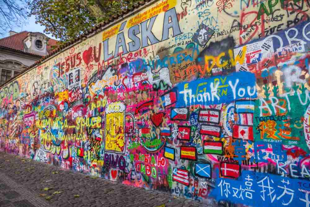 What can I do at John Lennon Wall in Prague?